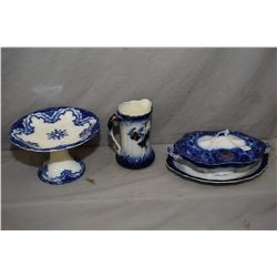 Three pieces of antique Flow blue china including lidded casserole dish, footed cake plate and a 7""