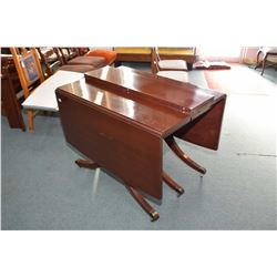 Mahogany drop leaf table with two insert leaves and table protector