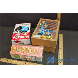 Day at the Circus - Elephant on Bike Tin Toy, Reproduction Power Boat Tin Toy & Pink Candy Popcorn m
