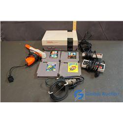 Original NES System w/(2)Controllers, Gun & (4) Games
