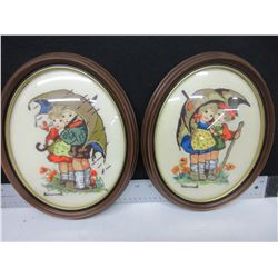 2 Needlepoint in oval bubbled curved glass frames