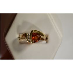 14KT GOLD RING W/ TRILLION CENTER GARNET