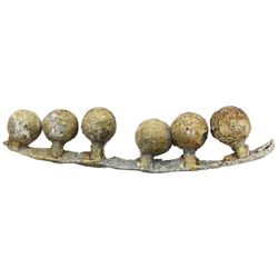 "Original rack of six lead ""half"" musketballs as from a mold, from the Joanna (1682)."