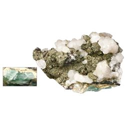 Natural Colombian emerald in stone matrix with pyrite and quartz agglomeration.