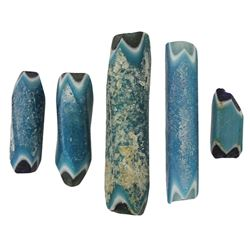 "Lot of five glass trade beads (""Nueva Cadiz turquoise""), Spanish colonial (1500s-1600s)."