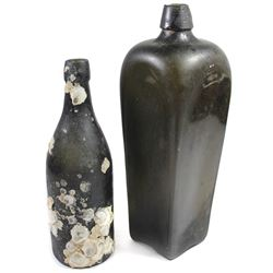 Lot of two black-glass bottles (one tall gin and one small ale) from the 1700s to early 1800s, found