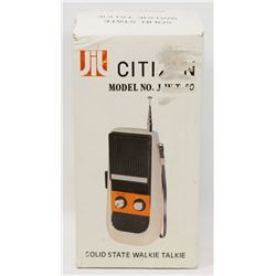 NEW SET OF WALKIE TALKIES .