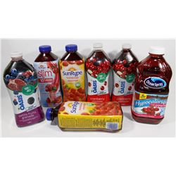 BAG OF ASSORTED JUICE BOTTLES