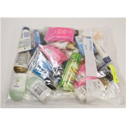 BAG OF TRAVEL SIZE BEAUTY ITEMS.