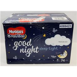 BOX OF HUGGIES OVERNIGHTS. SIZE 4. 74 IN BOX.
