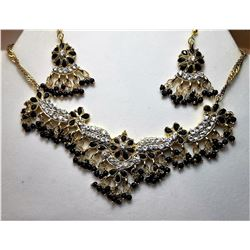 16)  GOLD TONE WITH CLEAR & BLACK CRYSTAL