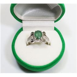 74) STERLING SILVER DIAMOND & GREEN STONE RING