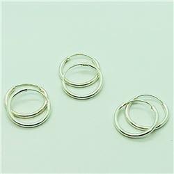 126) THREE PAIRS OF STERLING SILVER HOOP EARRINGS