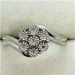 150) STERLING SILVER 7 DIAMOND RING
