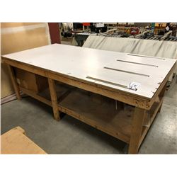 APPROX. 4' X 8' WORK BENCH WITH BUILT IN ROLLERS
