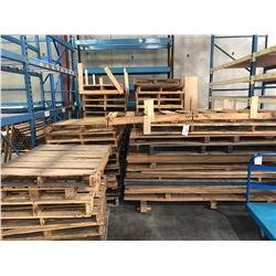 LARGE QUANTITY OF PALLETS INC. ALL PALLETS IN AREA, AND ALL UNUSED PALLETS IN WAREHOUSE, MUST TAKE