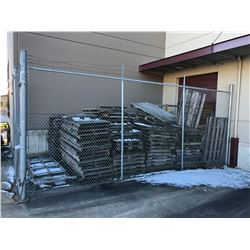 LARGE LOT OF PALLETS INC. ALL PALLETS IN ENCLOSURE BEHIND WAREHOUSE
