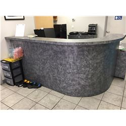 RECEPTION COUNTER WITH GLASSES, EAR PLUGS AND MISC ITEMS
