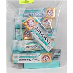 BAG OF ARM AND HAMMER TRULY RADIANT TOOTHPASTE.