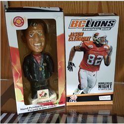 TWO BOBBLE HEADS IN PACKAGES