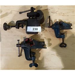 THREE SMALL CAST IRON BENCH VISES