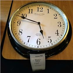"BLACK & WHITE STERLING & NOBLE WALL CLOCK/DAMAGED/APPROX 21"" DIAMETER"