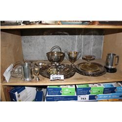 SHELF INCLUDING SILVER PLATED PLATTERS, FOREIGN MONEY, TROPHIES, AND MORE - SOME STERLING SILVER