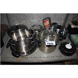 SHELF OF STAINLESS STEEL POTS, PANS, AND MORE