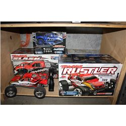 LOT OF RC TOYS INCLUDING TRAXXAS RUSTLER & THRASH AND LA TRAKS DESERT PRERUNNER
