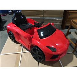 CHILDS RED RIDE ON BATTERY OPERATED EXOTIC SPORTS CAR WITH REMOTE
