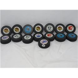 LOT OF 15 OFFICIAL PUCKS (NHL)