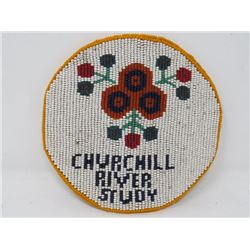 "PENDANT (LEATHER BOUND W/NATIVE CRAFT BEADING) *COMMEMORATING CHURCHILL  RIVER STUDY 1970s* (6"" DIAM"