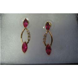 Red & clear swarovski crystal looping pendant on gold earrings