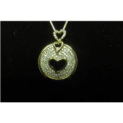 """Gold classic circle pendant with four rows of cubic zirconias surrounding a cut out heart c/w 16"""" bo"""