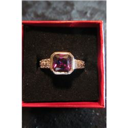 Princess cut purple swarovski crystal with clear swarovski crystal accents set in silver ring…size 8