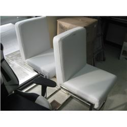 TWO WHITE FAUX BAR STOOLS