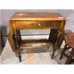 Antique coffee table magazine rack comes with plant stand