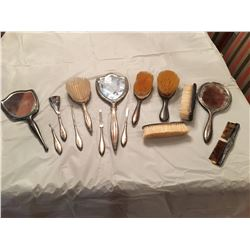 "Antique silver personal care items, mirrors, brushes, comb, several items marked ""Birks Sterling"""