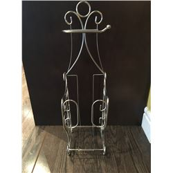 "Metal magazine rack about 24"" tall"