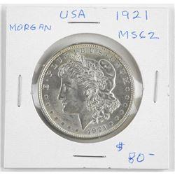 (LUN 09) 1921 USA Silver Morgan Dollar, MS62. (GR)