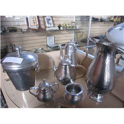 INDONESIAN HAMMERED METAL TEAPOTS, PITCHER, NAPKIN RINGS, AND LIDDED CONTAINER