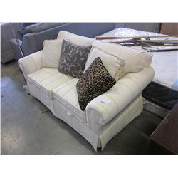 WHITE LOVESEAT WITH THROW PILLOWS