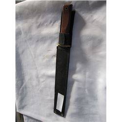 MACHETE IN BLACK SHEATH