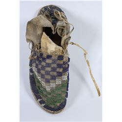 Moccasin (sinew sewn).  Item Removed for Cultural and Historical Preservation (87801)