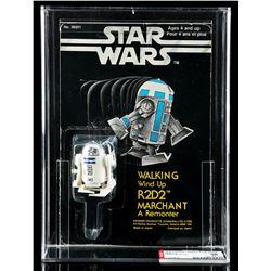 Lot # 74: Canadian Carded Walking Wind-Up R2-D2 AFA 60 [K