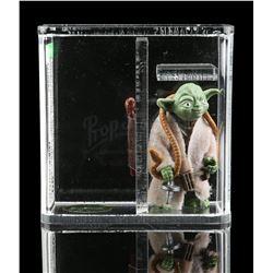 Lot # 355: Loose Yoda (With Brown Snake) AFA 90