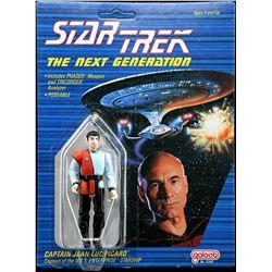 Lot # 536: Romulan on Captain Jean-Luc Picard Cardback Pr