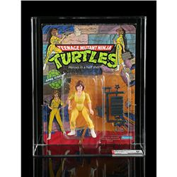 Lot # 580: April O'Neil Series 1 AFA 85