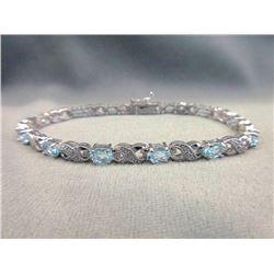 Blue Topaz & Diamond Figure 8 Tennis Bracelet