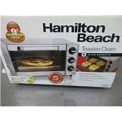 New Hamilton Beach Toaster Oven 4 slice capacity / stainless steel/auto shut off